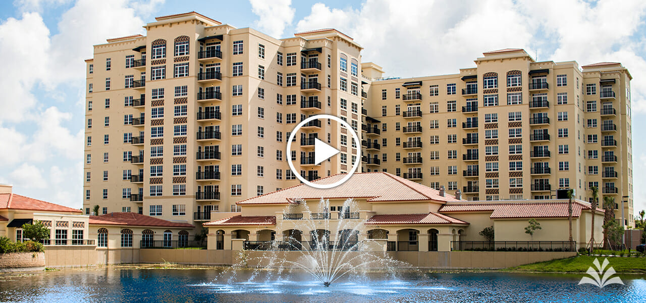 Lifestyle video of Levin Palace services and amenities. Beautiful lake with fountain on the foreground of the back of the Levin Palace.