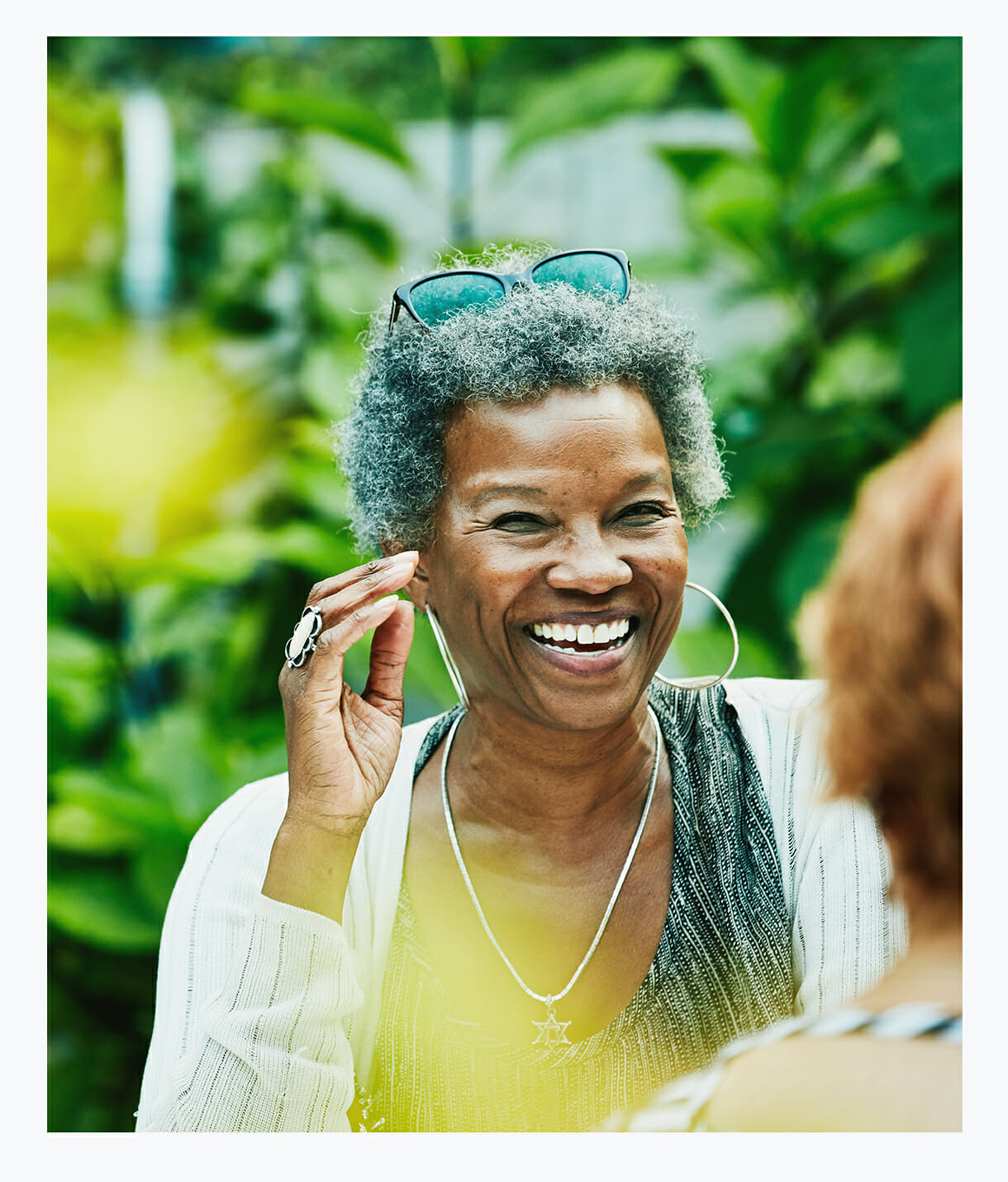 African-American senior woman enjoying the South Florida Sun in the Serenity Garden at MorseLife Memory Care Assisted Living