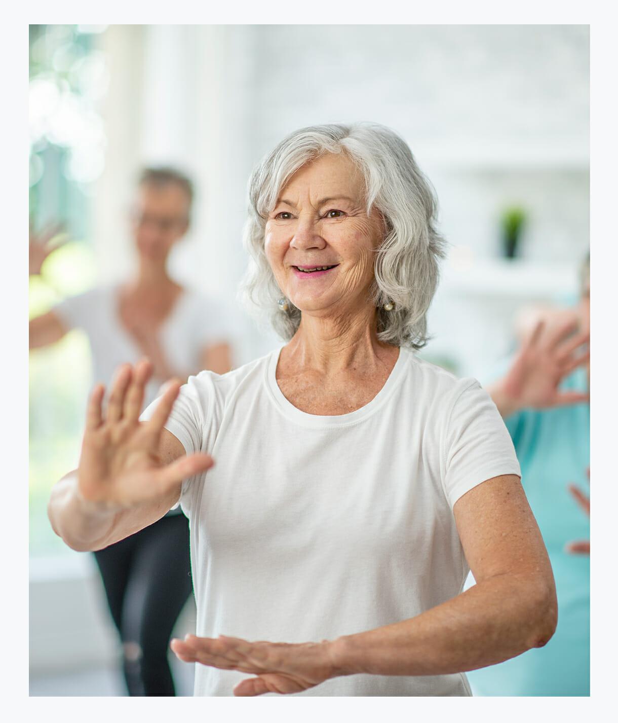 Senior woman enjoying in-home activities through Neighbor to Neighbor programs yoga tai chi reiki