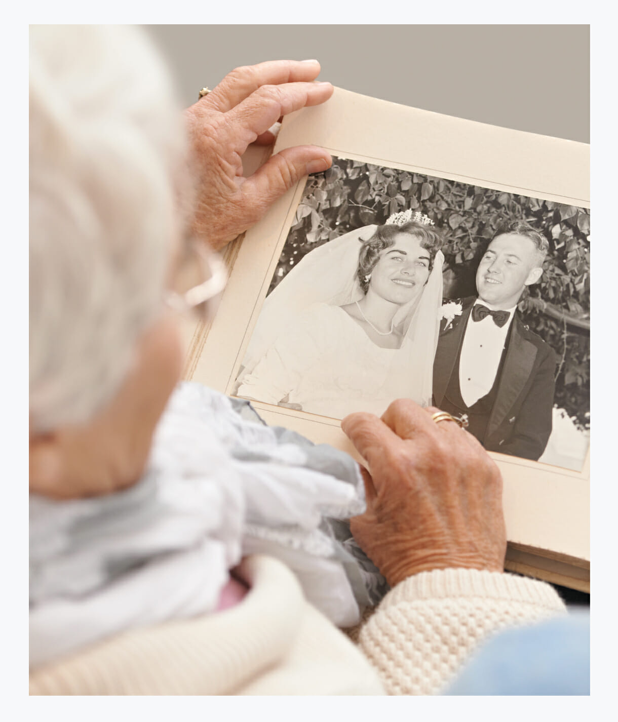 Memory Care Assisted Living resident looking at old photo, innovative memory stimulation, all-inclusive care