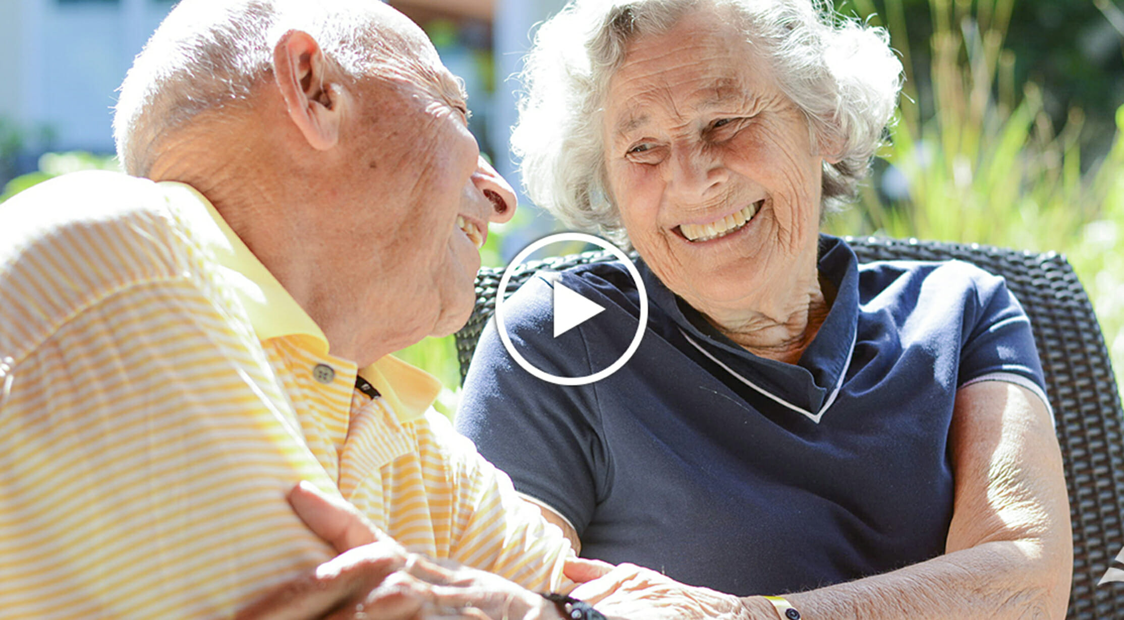 Independent living resident with Memory-Impaired spouse enjoying time together in Serenity Gardens, continuum of care