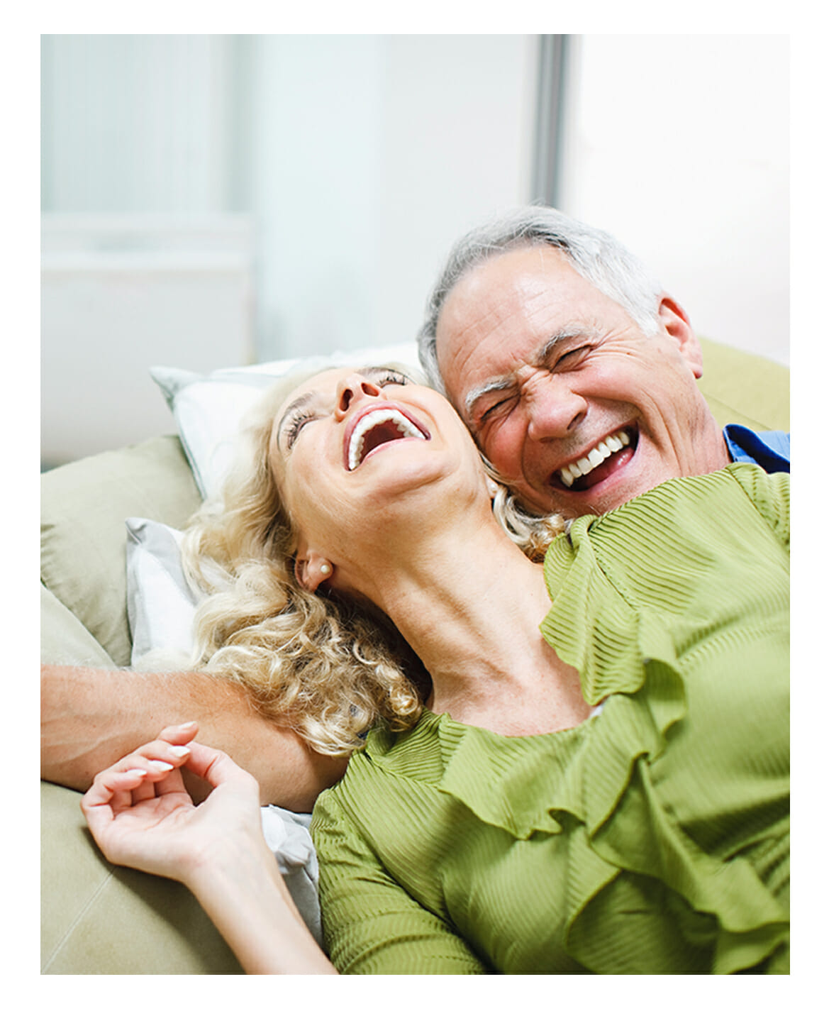 Senior couple laughing and enjoying the moment.
