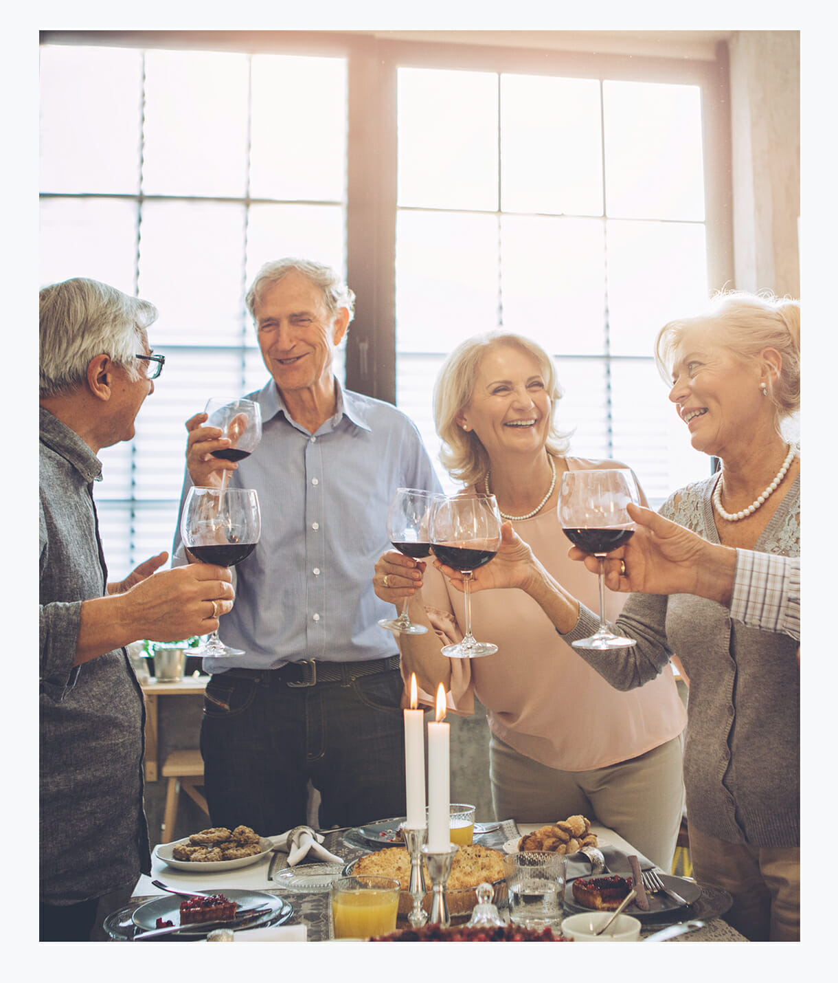 Older adults enjoying happy hour socialization with friends at Assisted Living