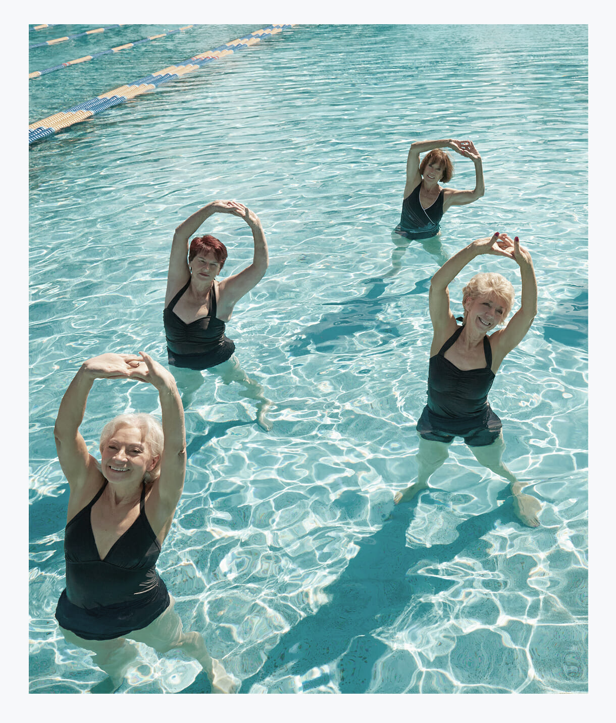 Four senior ladies enjoying aquarobics at Tradition's Indoor Pool