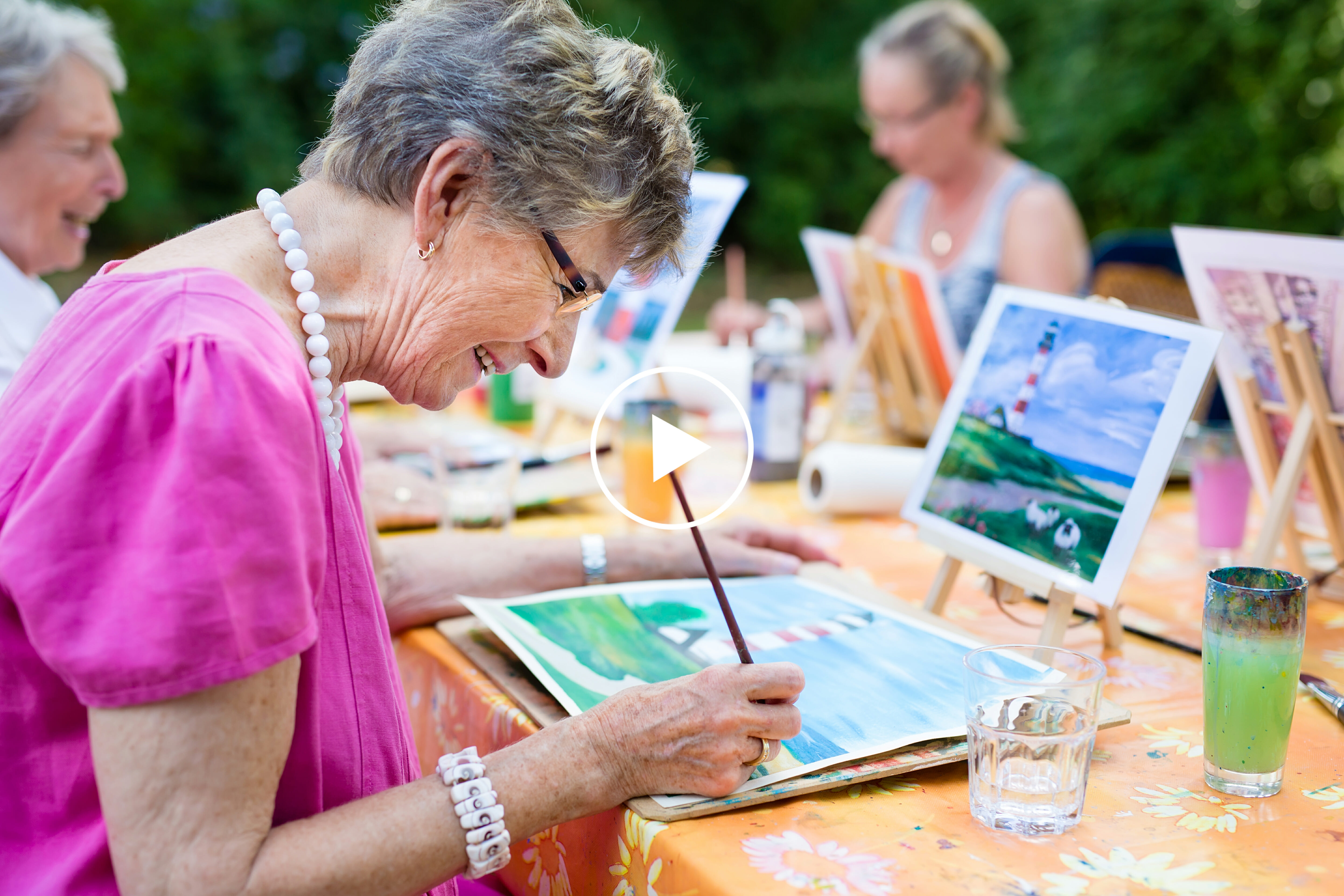 Senior lady assisted living resident participating in art classes innovative social programs world-renown entertainment in retirement home