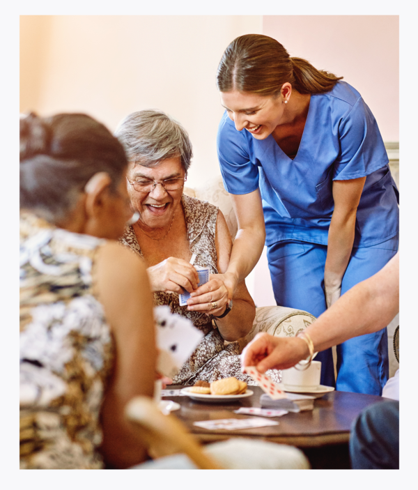 Home Care aide assisting elderly client in engaging activities