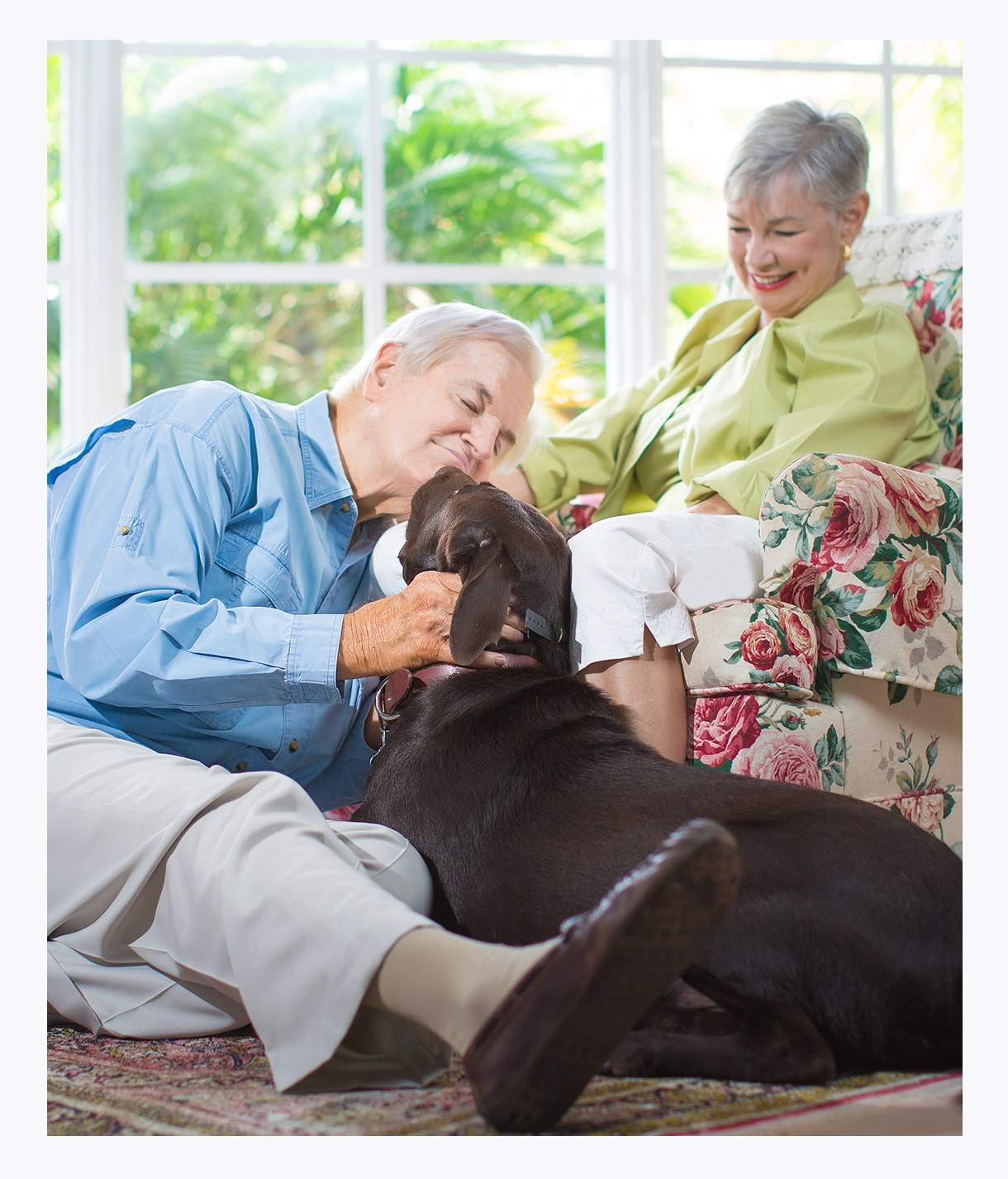 Elderly couple at home enjoying dog therapies, home care, medicaid, medicare, free transportation provided, onsite clinics