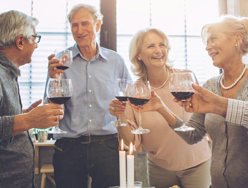 Assisted Living residents enjoying happy hour in a fun social setting.