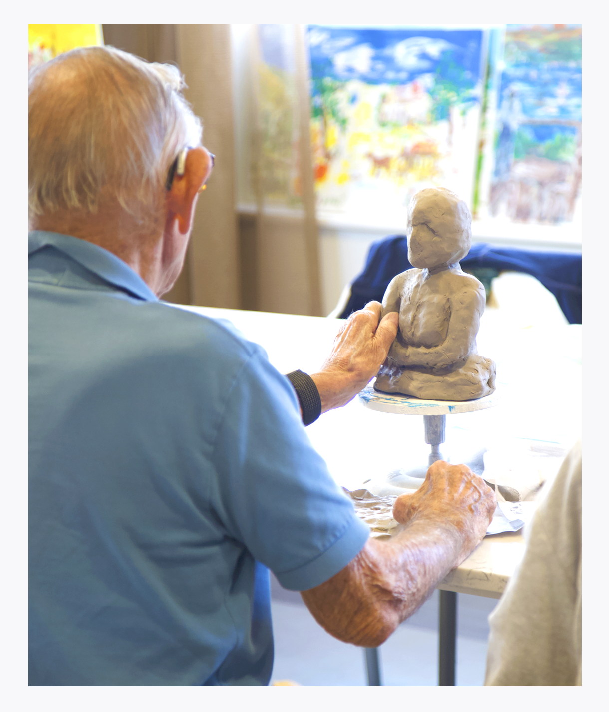 Older gentleman clay sculpting, Palliative Care Art and Music programs, comfort care, life enhancement