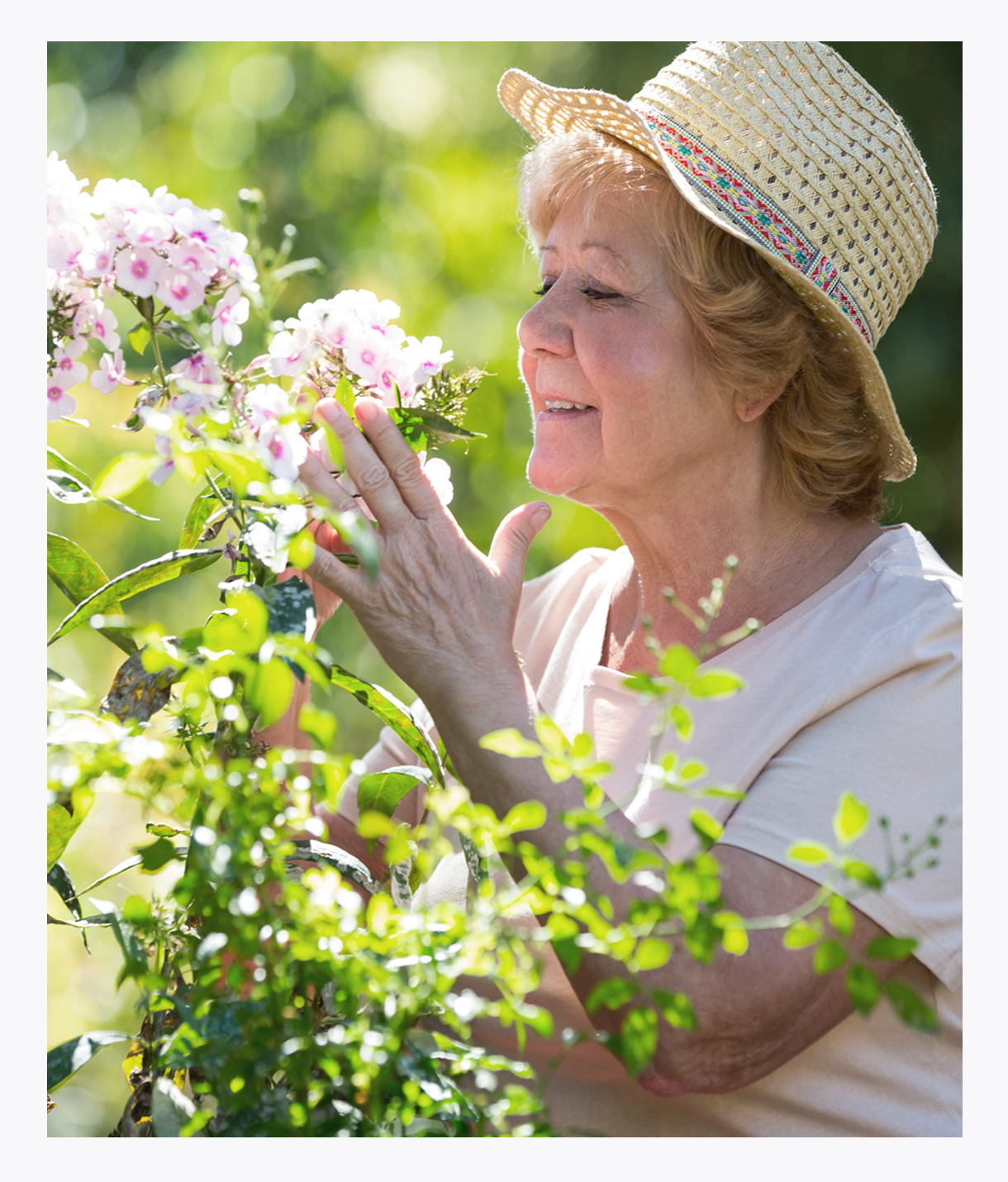 Senior woman smelling flowers, pain management, symptom management, quality of life
