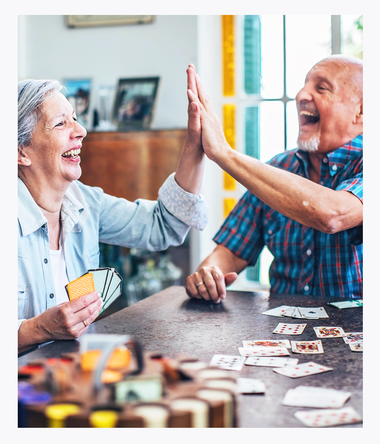 Seniors with chronic illness enjoying high-stakes card game, celebrating life, More Life, pain management, laughter is the best medicine